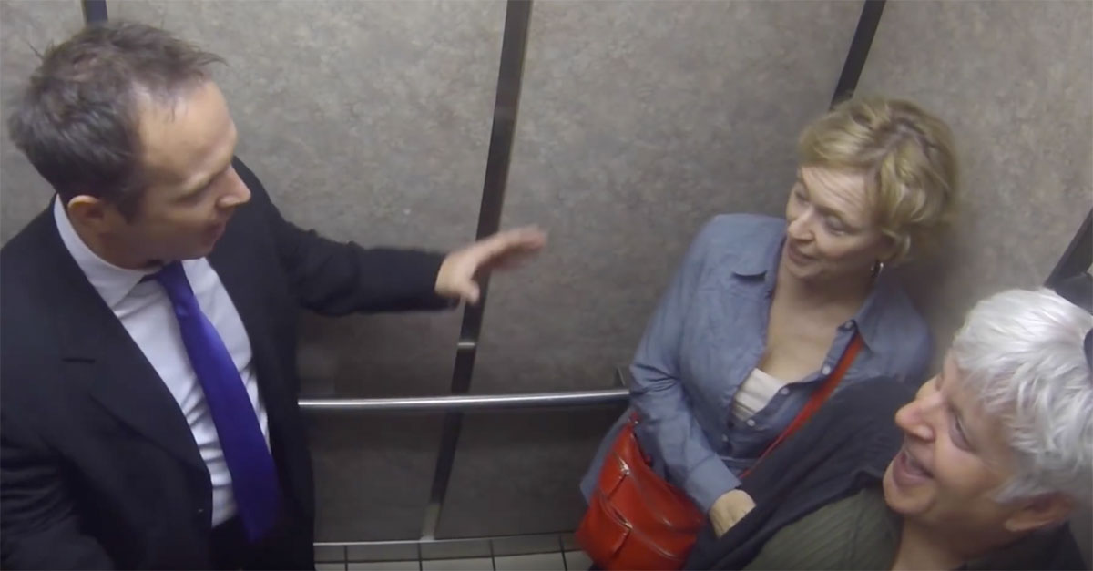 Man Pranks Elevator Passangers By Pretending To Do A Weather Forecast On An Elevator